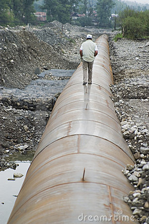 Man walking on pipeline