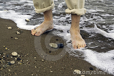 Man walking on sea shore