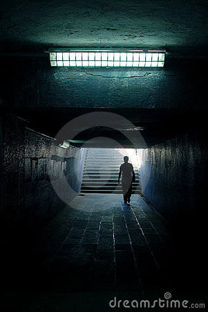 a man walking in the tunnel