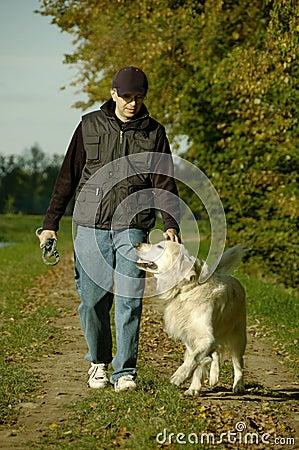 Free Man Walking With Dog Royalty Free Stock Photo - 3529375