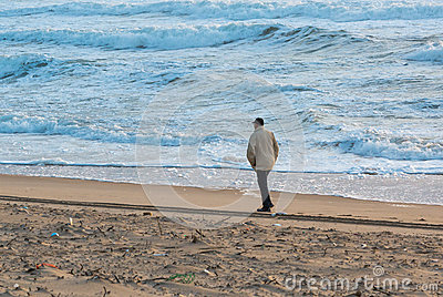 Man Walks Along Coast