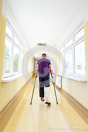 Man walks on crutches