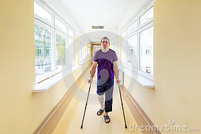 Man walks on crutches