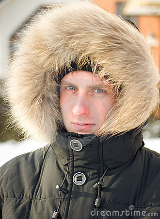 Man in warm jacket with furry hood