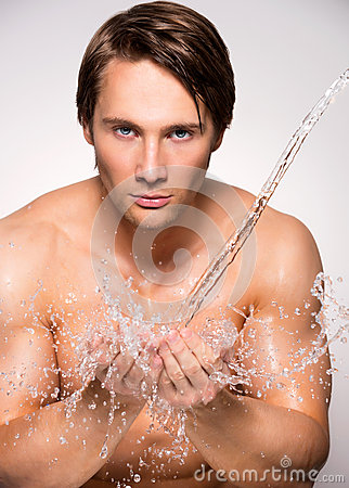 Free Man Washing His Face With Clean Water. Stock Images - 44484954