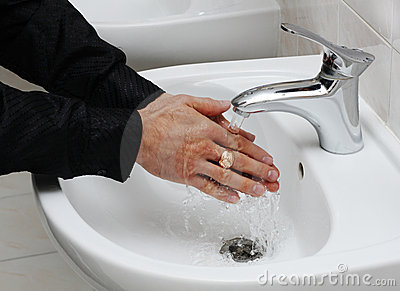 Man washing his hands under running water