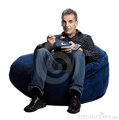 Man watching tv and eating