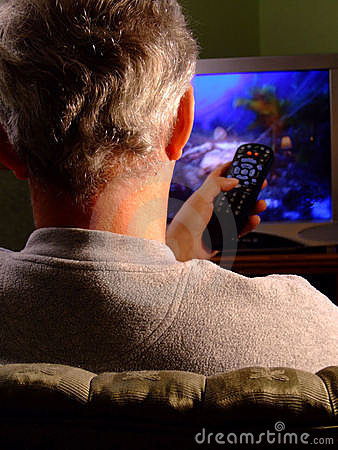 Man watching TV with Remote