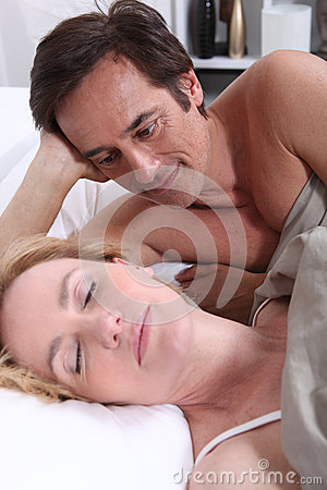 Man watching woman sleeping