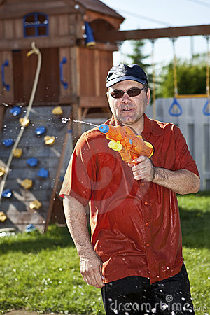 Man in a water gun fight