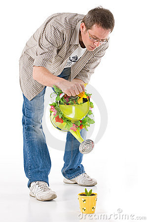 Man watering small plant