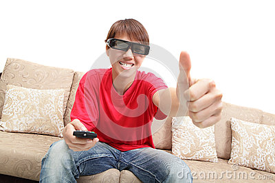 Man wearing 3d glasses watch tv and thumb up