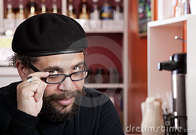 Man wearing beret in coffee house