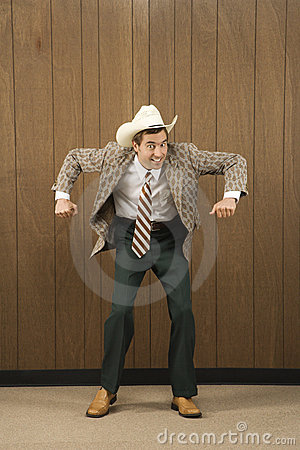 Man wearing cowboy hat dancing.