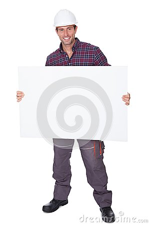 Man Wearing Hard Hat Holding Placard