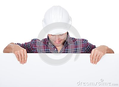 Man Wearing Hard Hat Holding Placard