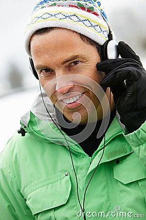 Man Wearing Headphones And Listening