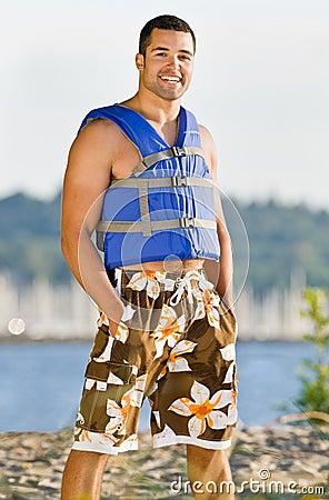 Man wearing life jacket at beach