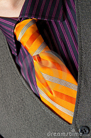 Man wearing orange necktie