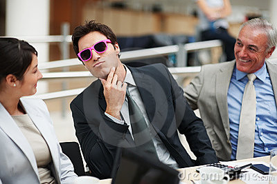 man wearing a pink framed sunglasses at a meeting
