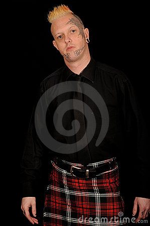 Man wearing plaid kilt