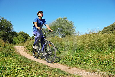 Man wearing sporty clothes is riding on bycicle
