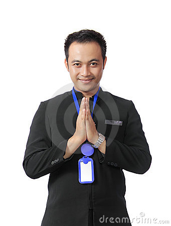 Man wearing suit with welcome smile