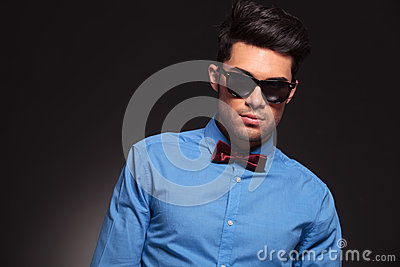 Man wearing sunglasses  and bow tie