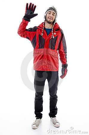 Free Man Wearing Winter Cap And Jacket Waving Hello Stock Photography - 7364222