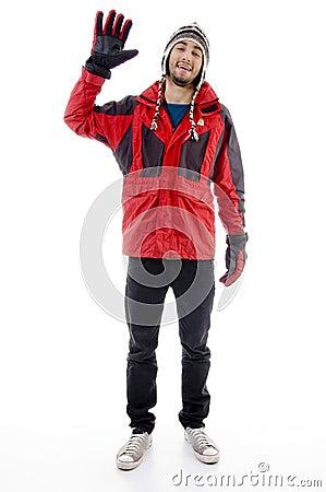 Man wearing winter cap and jacket waving hello