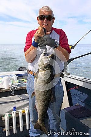 Free Man Weighing Large Fish - King Salmon Royalty Free Stock Photo - 18644955