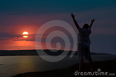 The man welcomes the sunset sun