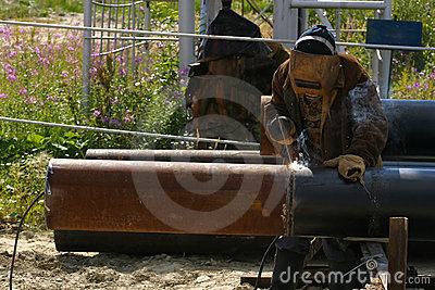 Man welding the pipe