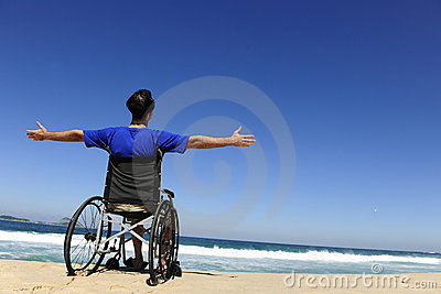 Man in wheelchair enjoying beach