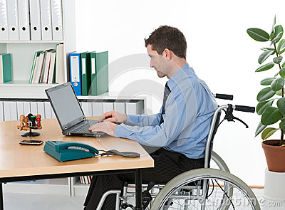 Man in wheelchair in the office