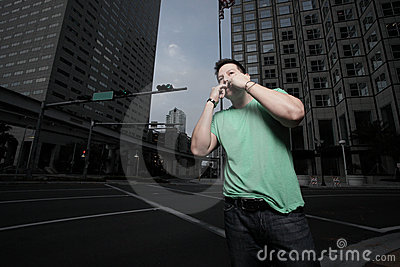 Man whistling for a cab