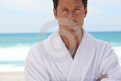 Man in white bathrobe outdoors