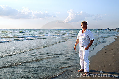 Man in white clothing at sea