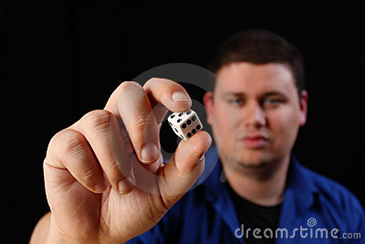 Man with white dice left