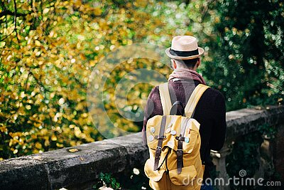 Man In White Fedora Hat And Beige Knapsack Beside Grey Concrete Railings During Daytime Free Public Domain Cc0 Image