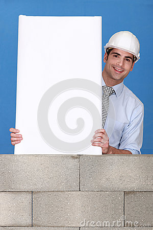 Man with white panel on wall