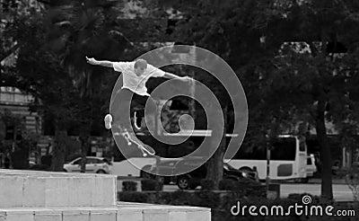 Man In White Shirt And Black Pants Playing Skateboard Near Green Tree During Daytime Free Public Domain Cc0 Image