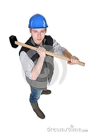 Man wielding heavy hammer