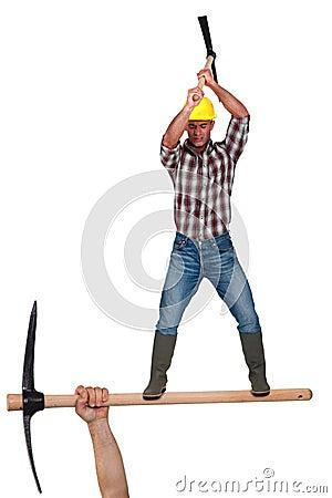 Man wielding pick-axe