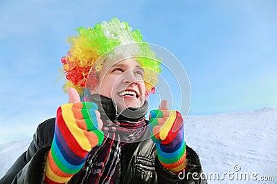 Man in wig of clown looks in sky