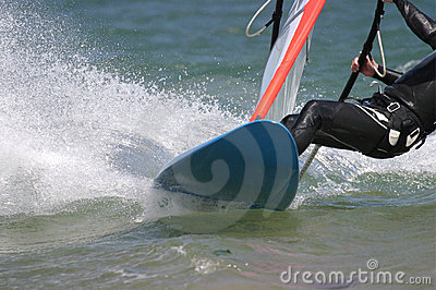 Man Windsurfing Board in Sea