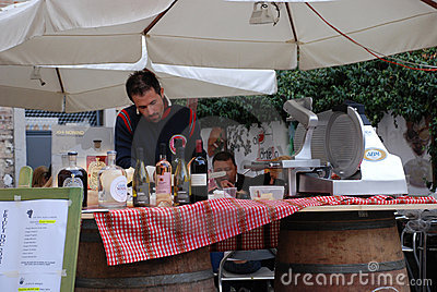Man at Wine and Ham Stall Editorial Stock Photo