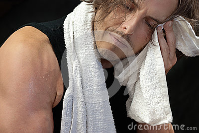 Man Wiping Face After Workout