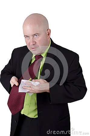Man wiping his tie