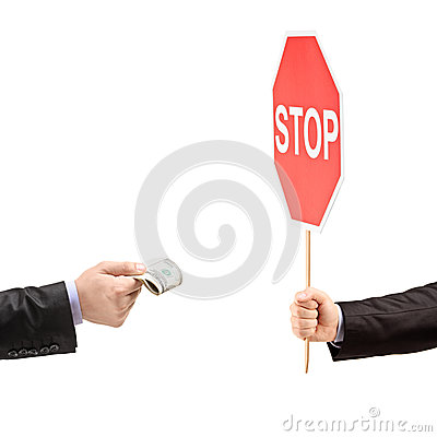 Free Man With A Stop Sign Saying No To Bribery Royalty Free Stock Images - 30511449